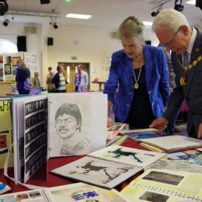 Mayor And Consort Looking At Malbank Pupils Artwork - Click to open full size image
