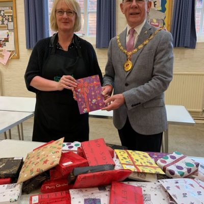Mayor Presenting Food Bank With Gifts