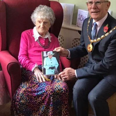 Mayor Presenting Resident With 100th Birthday Card - Click to open full size image