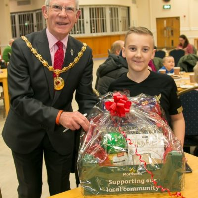 Mayor Presenting Youngster With Prize For Turning On Christmas Lights