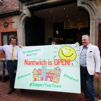 Market traders holding a Nantwich is Open banner