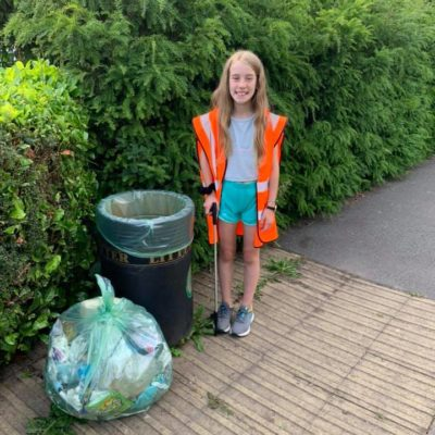 Young Girl Collecting Litter